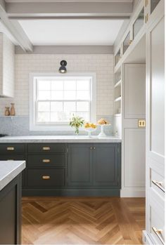 Build out a doorway with cabinetry!  I love this for the north end of the kitchen. It would shorten the length, making the room more cohesive, without losing valuable storage space.