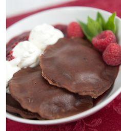 Chocolate Dessert Ravioli with creamy Amaretto filling and Chambord raspberry sauce.
