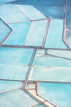 Simon Butterworth hung out of a plane to capture stunning views of the Useless Loop Solar Salt Operation in Australia.