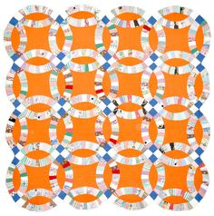 Orange Crush: Double wedding ring quilt, c.  1950, posted by Bill Volckening at Wonkyworld