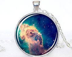 The Silver pendant is 30mm and comes with a Silver metal 24 chain necklace.  For more Nebula pendants click the link below: http://www.etsy.com/shop/ThePendantIsland/search?search_query=galaxy&order=date_desc&view_type=gallery&ref=shop_search  Cassiopeia A (Cas A) is a supernova remnant in the constellation Cassiopeia and the brightest extrasolar radio source in the sky at frequencies above 1 GHz. It had a flux density of 2720±50 Jy at 1 GHz in 1980; its flux density at 1 GHz is decreasing…