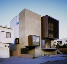 """Residential Architecture: Orange Grove by Brooks + Scarpa: """"..contrasts the area's omnipresent bungalow house. creating a landmark in the town, the structure isformed with a series of cubes which penetrate the segmented facade, breaking down the larger scale in relation to the surroundingsingle family homes. multiple baconies overlooking the street to create a relationship with the public entity, reclaiming the notionof communication and impromptu interactions with passersby..a human…"""