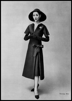1957 - Renée Breton in Christian Dior black Alaskine (silk and wool blend) dress with underskirt, by Georges Saad,