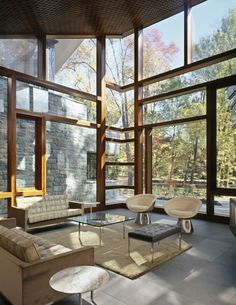 love this living room! Definitely would have to hire a window washer, though. :-)