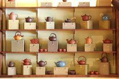 Display teapot on top and cups and saucers stacked inside!  Make the boxes to fit exactly what we have and to be varied in sizes.