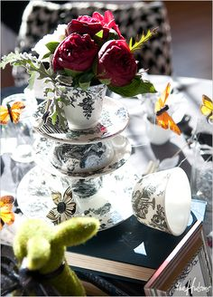 Absolutely in love with these teacup centerpieces for an Alice-in-Wonderland theme at the reception. - Photo by Jason