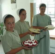 ~ Amish Young People ~ Sarah's Country Kitchen ~ Young Ladies ready to Serve Homemade Pies. Amish Village, Amish Books, Amish Family, Amish Culture, Holmes County, Amish Community, Pennsylvania Dutch, Amish Country, Christmas Sweaters