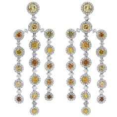GIA Certified Platinum Fancy Yellow Diamond Chandelier Earrings | From a unique collection of vintage chandelier earrings at https://www.1stdibs.com/jewelry/earrings/chandelier-earrings/
