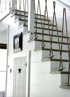 Creative railing made with rope anchored by horn cleats.