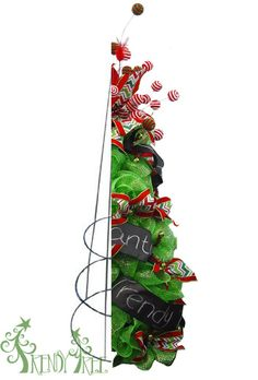 Christmas tree made from a tomato cage, deco poly mesh, chalkboard ribbon, ball sprays and chevron ribbon, includes video tutorial at Trendy Tree. Mesh Christmas Tree, Holiday Wreaths, Christmas Holidays, Tomatoe Cage Christmas Tree, Porch Xmas Tree, Xmas Trees, Prim Christmas, Christmas Lights, Tomato Cage Crafts