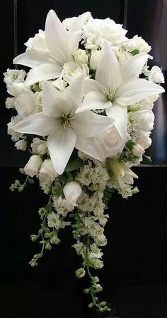 Cascade version of Bride's Bouquet, similar flowers, but white lilies with pastel flowers