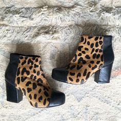 """Animal Print Boots TOPSHOP London TOPSHOP animal print ankle boots. Real animal hair.  Tan and black boots. Size:37.  Mid- size heel about 3"""" high. Topshop Shoes Heeled Boots"""