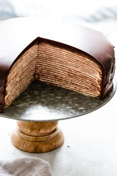 Delicious and surprisingly easy recipe for chocolate crepe cake from Anna Banana Co. Beautiful layers of soft crepes with whipped chocolate cream create this visually stunning cake, making it perfect for any occasion! Just Desserts, Delicious Desserts, Dessert Recipes, Crape Cake, Chocolate Crepes, Chocolate Cupcakes, Crepe Cake Chocolate, Anna Banana, Crepe Recipes