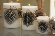Candles with Latvian symbols