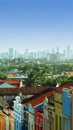 The colorful and colonial city of Olinda with a view of Recife skyscrapers line, Pernanbuco State, Brazil