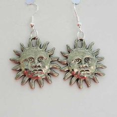Silver colored grumpy sun earrings New Age jewellery of a sun and face with a rather unsmiling look Drop style all silver tone for pierced ears