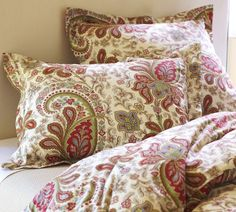 Right now I have a plain brown comfortor with semi matching brown curtains. This looks cheerful.