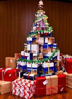 Recycled boxes christmas tree, different and can teach the boys how to wrap, recycle and make a cool tree.
