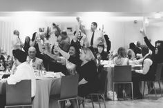 Guests toast during a wedding reception at the Maritime Parc in Jersey City, NJ. Captured by NYC wedding photographer Ben Lau.