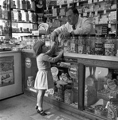 View top-quality stock photos of England 1955 A Little Girl Is Pictured In A Sweetshop. Find premium, high-resolution stock photography at Getty Images. 1970s Childhood, My Childhood Memories, Old Pictures, Old Photos, Ddr Museum, Nostalgic Images, Old Country Stores, Robert Doisneau, Teenage Years