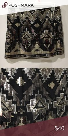 Express Aztec sequin skirt Black with silver sequins in Aztec print. Never worn, no tags. Pull on skirt, no zipper. Express Skirts Mini