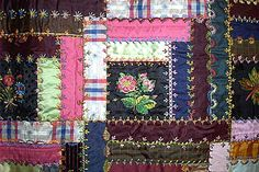"""A Log Cabin """"Show"""" Quilt circa 1890 made by Emily Jacobs Gillingham Pierce Hadley (1817-1906) was created with primarily silk and satin cloth, and is decorated with elaborate crazy quilt style embroidery."""