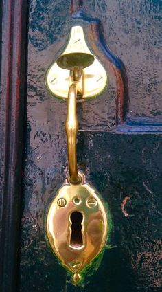 Traditional brass latch on mansion door in Mahon, capital of Menorca, Spain