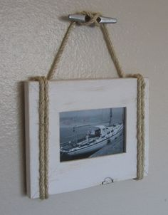 Fun way to hang things in a nautical room!