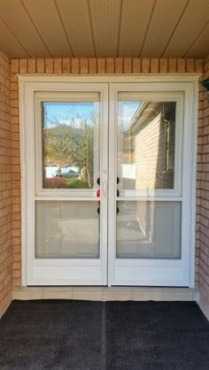Double larson storm doors give the look of french doors for Double storm doors for french doors