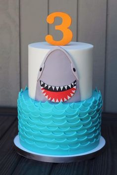 Shark cake, would be adorable for a ocean theme birthday! Fin Fun mermaid also makes swim-able shark fins for all your party goers! Check them out at FinFun.com