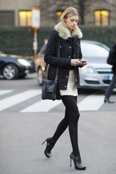 Black tights, camel mini skirt, black tee, furry jacket & black high heeled booties.