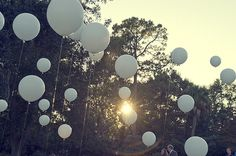very cute odd sized white helium balloons