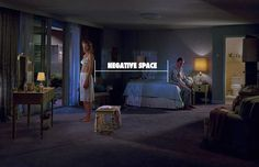 Photograph by Gregory Crewdson using negative space to create tension.