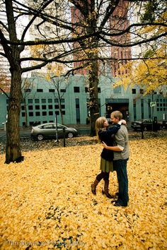 Portland Engagement photos! The Portland building's in the background...I love the contrast of the yellow and teal.