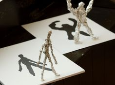 Foil figures and their shadows.