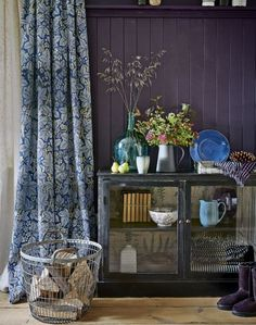 Intense Purple Hallway with Display Cabinet and Leaf-patterned Curtain - The Room Edit