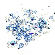 Mixed pack of Swarovski 155pcs  Contains:  Crystal Moonlight  - SS7 30pcs  - SS12 20pcs  Sapphire AB  - SS7 30pcs  - SS20 10pcs  Light Sapphire  - SS7 30pcs  - SS12 20pcs  - SS20 10pcs  Shapes 1pcs each  - 2708 AB  - 2205 AB 2pcs  - 2205 CLEAR 2pcs