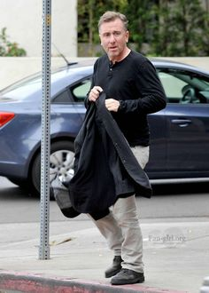 Tim Roth, male actor, celeb, powerful face, intense eyes, portrait, in the street, photo