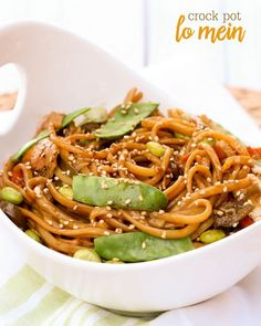 Delicious Crock Pot Chicken Lo Mein recipe filled with edamama, snow peas and more - a new favorite dinner recipe. { lilluna.com }