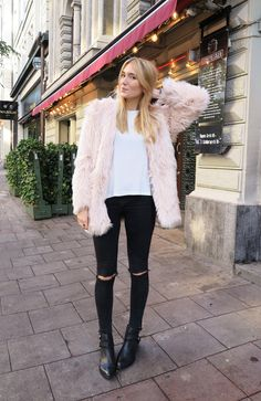 fuzzy pink jacket, white shirt and black skinnies
