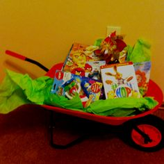 If your little boy is too old for an Easter basket this is a great idea. Bought wheel barrow at a farm store and collected all his favs add some green tissue paper for grass and you're all set! You could use anything really, a wagon or for (big) little girls a doll stroller or buggy! Hoppy Easter!