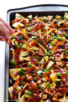 These chicken enchilada nachos are fun, flavorful, and fully-loaded with all of your favorite chicken enchilada ingredients!