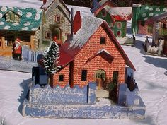 "Large 1928 Japanese Christmas village house, called a ""printie."" Printies are characterized by lithographed brick sides or plain colors with lithographed stone masonry around the doors and windows."