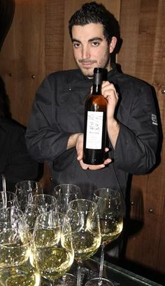 Iago Pazo, partner in Abastos 2.0, Mercado de Abastos, Santiago de Compostela, shows off one of his wine discoveries.  Photo by Gerry Dawes©2010 / gerrydawes@aol.com / Facebook / Twitter / YouTube / Pinterest.