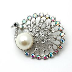 Silvertone Crystal Peacock Brooch Pin Fashion Jewerly PammyJ Brooch Pin. $15.99. GORGEOUS FOR GIFTS. NICKEL AND LEAD FREE. COMES IN FOIL GIFT BOX. SPARKLING RHINESTONES. PERFECT FOR BIRD LOVERS. Save 45% Off!