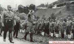 "Adolf Hitler reviews an SA unit in Berchtesgaden in July 1932. The formation was held in a meadow at the side of Koch-Sternfeld-Straße, near the Hofbräuhaus, below Nonntal Straße. At Hitler's side is his adjutant Wilhelm Brückner. At the bottom, an SA member displays the oldest flag of the Austrian Nazi movment (""Salzburg Erwache!"").  (period photos from ""Deutschland erwacht - Werden, Kampf un Sieg der NSDAP,"" Hamburg, 1933; bottom - from Heinrich Hoffmann, ""Das Braune Heer,"" Munich, 1932…"