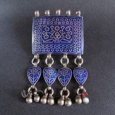 Old silver pendant with blue enamell from Multan (Madinat-ul-Awliyah: the City of Saints) in Pakistan.