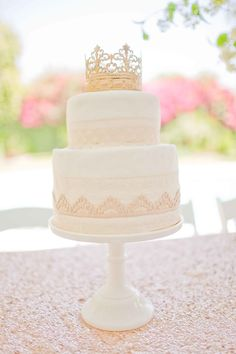 "For an old-world glam shower, a crown cake topper made a royal statement. ""My sisters and I have put my mom's cake skills to good use,"" Summer Watkins says. ""She makes a tiered cake for every single shower (baby or wedding) that we host at her house (which, with all of our girlfriends getting married and having babies, is several a year!). It's always special to have sweet handmade elements like that!"" The gold crown cake topper is now a keepsake in the baby's nursery. Source: Grey Likes Bab..."