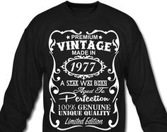 Birthday Design in white Velvety print on a Quality Women's Wide-neck Sweatshirt 40th Birthday Gifts - This is unique personalized birthday gift for anyone who is turning 40 this year.  The unique design says: Premium Vintage - Made in 1977 - A Star Was Born - Aged to Perfection - 100% Genuine - Unique Quality - Limited Edition.  ----  Product Quality: Womens Wide-neck Sweatshirt  An 80s twist on a classic style. Super soft and lightweight triblend sponge fleece sweatshirt with extended…