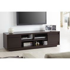 Two lower cabinets on the sides provide additional storage for movies, games and other items you want to keep close at hand but out of sight. Made from metal and MDF with a sleek veneer, this TV console is as durable as it is stylish.